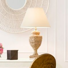 """Our Ida takes a classic silhouette, which gives it a casually contemporary update. While urn-shaped lamps are often seen in ceramic or metal, this unique piece is covered in woven natural fiber and set atop a chunky round crystal base.   Dimensions: Overall: 16""""Dia x 31""""H Lamp Base: 8''Dia Lamp Shade: 16""""Dia x 11""""H"""