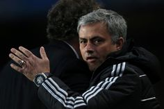 Chelsea's Portuguese manager Jose Mourinho (R) greets Paris' French coach Laurent Blanc (L) before kick off of the UEFA Champions League quarter final second leg football match between Chelsea and Paris Saint-Germain at Stamford Bridge in London on April 8, 2014.