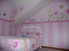 Hand painted stripes and flower border in twin girls room to match Pottery Barn bedding. Checkered border... Pink on Pink of course!