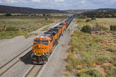 https://flic.kr/p/MTKaqg | 2016-09-21 1526 BNSF 8253 on Tank Train, Scholle, NM | Wednesday afternoon we were back on the BNSF Clovis Subdivision. From the US60 overpass at Scholle, NM we see a WB tank train heading into Abo Canyon. The east end of the canyon starts on the opposite side of the bridge.