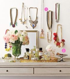 Suzie: Vanity vignette with round gold mirrored tray, gray washed dresser and silver leaf ...