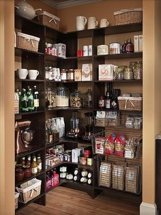 Beautiful pantry! - pretty shelving with cereal and snacks in pretty jars and baskets, so organized