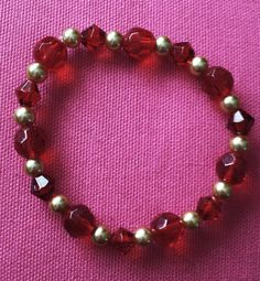 Hey, I found this really awesome Etsy listing at https://www.etsy.com/listing/182458475/stretchy-bracelet-in-red-glass-and-gold