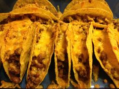 Baked Tacos - 2lb ground beef, 1 can refried beans, 8 oz tomato sauce, 1 pkg taco seasoning, 1 1/2 cups shredded cheese, 18-20 hard taco shells.  Brown ground beef & drain fat. Add beans, tomato sauce & seasoning. Spoon into taco shells. Sprinkle with cheese & bake standing up - 400*, 10-12 min.