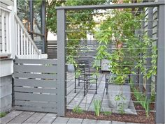 Vertical Garden Supports -- gray painted wood and wire trellis. #backyardlandscapediyprivacyscreens