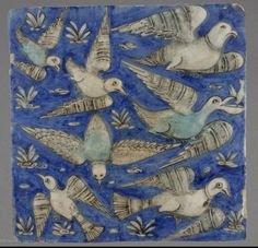 Revetment tiles, Iran circa 19th century.  Pattern of gray and turquoise birds flying on blue background.