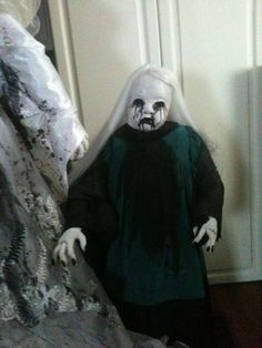 halloween prop creepy spooky child ghost creepy doll face. $65.00, via Etsy.