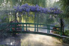 Japanese bridge over a misty pond covered with wisteria at Monet's garden. Giverny, France (photo: Phillipe Perdereau)