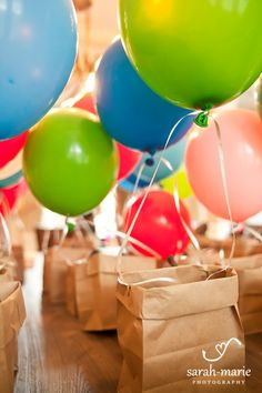 Hot Air balloon party favor Up theme party, fold a lunch sack paper bag to make the basket and then tie a balloon to it with two strings