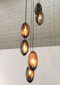 Tamera Leigh Staten's beautiful Oona lights were made of smoked blown glass and a movable copper section that slides around to reveal an opening for changing the bulb.