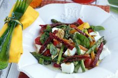Quickly grilled asparagus, mozzarella and all fresh ingredients make up an outstanding salad.