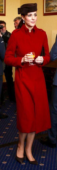 "LK Bennett's 'Ami' coat, 'Betty Boop' hat by Lock&Co, Mappin & Webb ""Empress"" White Gold & Diamond Drop Earrings, Natasha Clutch by Emmy Shoes, Cartier Ballon Bleu wristwatch, and ** shoes"