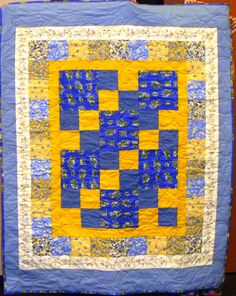 A cheery kit quilt, beautifully long armed by Linda Christensen.