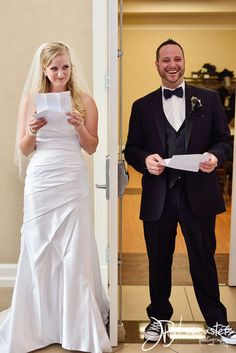 Reading one another's letters before the ceremony! Such a cute moment to have a photo of! Photo by: JB Lancaster Photography