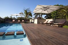 Photos by Grant Pitcher Large Umbrella, Outdoor Pool, Outdoor Decor, Wooden Decks, Pool Designs, Swimming Pools, Decking, Patio, Luxury