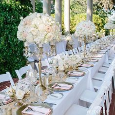 The dining tables topped with tall, full floral #centrepieces in pastel hues, certainly delivers the feeling of old-world romance. #wedluxe