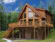 I've always been drawn to prow homes such as this ever since I was young. I see myself looking out those big windows to a beautiful mountain lake. And so it is! lake house plans | Log Home Floor Plans | Mountain Creations Log Homes Floor Plan NAME #LogHomeDecorating