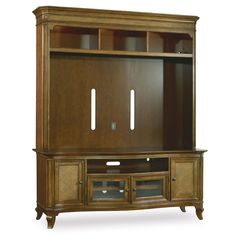 Bring a relaxed, yet elegant feel to your entertainment space with this wall unit. The tropically inspired piece features raffia accents and a mellow light brown finish. Ample open and concealed storage ensures plenty of space for media devices and accessories, while smart features like touch lighting, a three plug outlet, and cord access holes make it easy and safe to setup the perfect media unit.