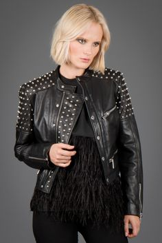 LOEB | ANAAGA Biker jacket in lamb leather with metallic studs and four zippers at the front.