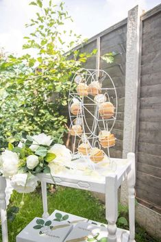 Take a look at this gorgeous rustic garden birthday party! The cupcakes are so pretty See more party ideas and share yours at CatchMyParty.com  #catchmyparty #partyideas #rusticparty  #girlbirthdayparty #gardenparty #cucpackes