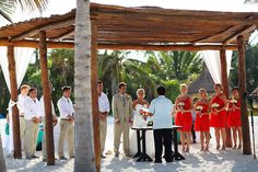 Wedding at Secrets Maroma Riviera Maya, such a pretty ceremony on the beach! Love the bridesmaids in red.  Mexico wedding photographers Del Sol Photography