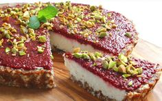 Make jam with chia - This stunning coconut tart is absolutely delightful to eat and easy to make. Its simple date and almond crust is topped with a creamy coconut layers and finished with some homemade chia jam. Raw Vegan Desserts, Raw Vegan Recipes, Coconut Recipes, Vegan Cake, Vegan Treats, Healthy Dessert Recipes, Gluten Free Desserts, Delicious Desserts, Healthy Potluck