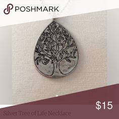Tree of Life Necklace This is a silver tone Tree of Life pendant. It is teardrop shaped with a delicate engraving. It hangs on a silver tone chain. Jewelry Necklaces