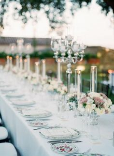 A fabulous wedding reception in the garden with the most heavenly details – antique silver candelabras everywhere that magically lit up the night! Fabulous ivory, white and light and dusty pink floral arrangements with textured greenery were at every table. | #weddingreception #weddinginspiration #gardenwedding #candelabras #floraldesign #greenery #ivorywedding