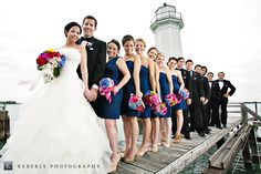 wedding pose around lighthouse | Keberly Photography specializes in unique graduate photos and wedding ...