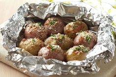 Get it all done on the grill with this foil-packet technique. New potatoes are infused with tangy dressing and savory Parmesan for a no-mess, delectable side dish.