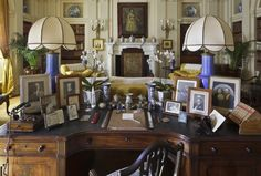 Desk in Polesden Lacey's Library where photographs of the royal couple are displayed.   'I was so happy in the days when they used to run in and out of my house as if they were my own children'   Mrs Greville, in 1937 quoted by Harold Nicolson