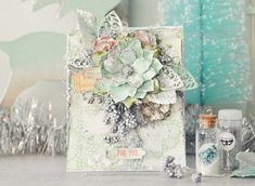 """I just love the mint colour out of the Sweet Peppermint collection, so I chose to use this colour as the main feature of my card.  I love to layer flowers, so I did this up along the top of my card along with lots of Christmassy leaves.  I used the Moroccan Foliage Dies to add to the cluster of pretty leaves.  And I finished off with some Art Stones and Metallique Silver Spoon paint."" ~ Stacey Young"