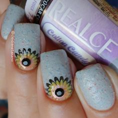 Sunflower nail art at the moons by @cleidianetakano