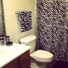 I have this same shower curtain, towels,etc. but my toilet has it on it too. I did the toilet in zebra duct tape. awesome #ZebraPrintBedding