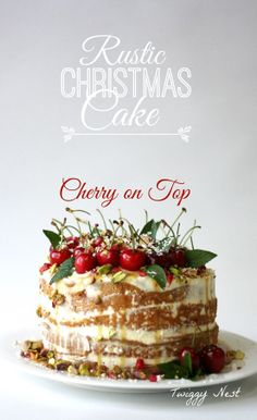 Rustic Christmas Cake with cherries, butterscotch sauce, mint, pistachio, pomegranate seeds, white chocolate and cream.