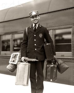 1930s 1940s Man Red Cap Porter Carrying Luggage Bags Suitcases Passenger Railroad Train