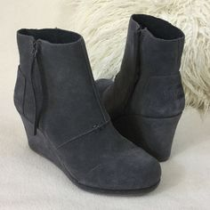 """TOMS BRAND NEW grey suede wedge ankle boots TOMS BRAND NEW grey suede wedge ankle boots with side zipper for easy on/off. 3.5"""" wrapped suede wedge. Excellent condition never worn just one tiny faint spot as pointed out in 2nd pic.  Insoles measure 9 3/4"""" long for reference TOMS Shoes Ankle Boots & Booties"""