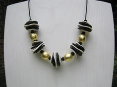 Black and white and gold polymer necklace. $145.00, via Etsy.