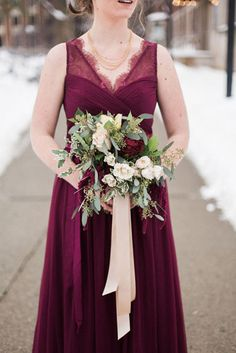 Ann arbor michigan winter wedding bridesmaid bouquet in blush and burgundy featuring marsala peonies, blush majolica spray roses, cranberry tess garden roses, seeded and silver dollar euclayptus, and blush trailing ribbon. Flowers by redpoppyfloral.com