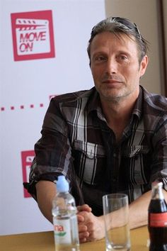 Mads wearing glasses on the top of his head.