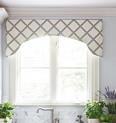 Something similar to this, with a little color, above the kitchen window.