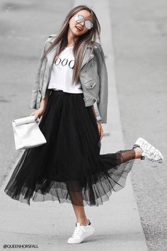 - A knit tulle maxi skirt featuring a smocked back and a flared hem.