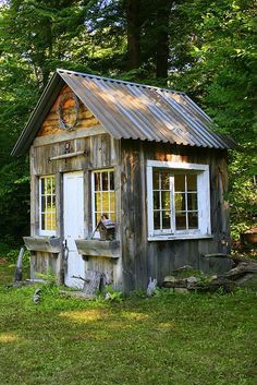 art studio -- love everything about this -- the metal roof, the different woods, the old windows, the flower boxes.... cool.