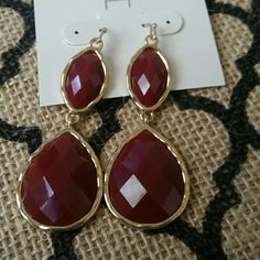 Burgundy Double Drop Earrings A beautiful color make these earrings a must have! Add a double drop of beautiful to any outfit!  2 inches long Burgundy and gold tone in color Twang Boutique  Jewelry Earrings