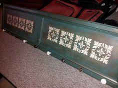 Coat rack made from an old kitchen cabinet door & dresser knobs!