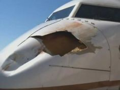 A hole in the nose of a United Airlines Boeing 737 after a collision with a bird on a Denver International Airport approach (© The Denver Channel, http://aka.ms/BirdPlane)