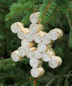 Wine Cork Snowflake Christmas Ornament -  Christmas ornament made by cutting wine corks in half and gluing them together to make a snowflake…