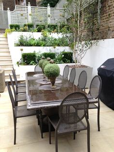 BUTTER WAKEFIELD GARDEN DESIGN Here Butter's clients cleverly chose furniture by OKA, dining table and chairs which look lovely!