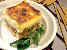 Pastitsio, this classic Greek dish of baked pasta, minced meat and bechamel sauce is loved by all the family and a must in every Greek household. Yummy Pasta Recipes, Greek Recipes, Cooking Recipes, Cookbook Recipes, Italian Recipes, Dinner Recipes, Greek Dishes, Italian Dishes, Main Dishes