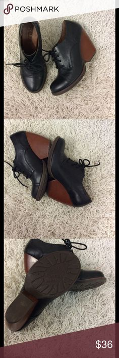 Korks funky black leather tie up shoes/platforms Fun and funky heel KORK  lace up black shoes with  brown funky heels Length of shoe from toe to heel on the inside of shoe is 10 1/2 inches Width of shoe is three and three-quarter inches Leather uppers made man material rest of shoe Height of heel is 3 1/2 inches Very good gently used condition Size is 40 or 9 1/2 korks Shoes Wedges